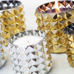 gold and silver spiked vessel candles