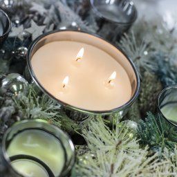 candle with festive accessories