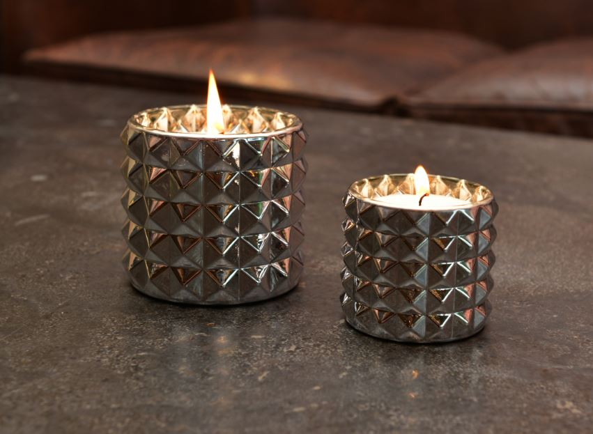 Silver smoked diamonds candles on table