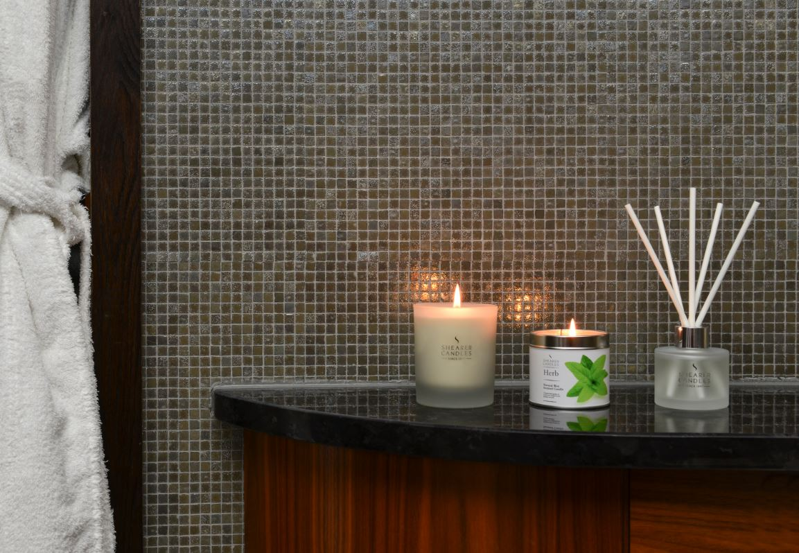 Candles and diffuser in bathroom