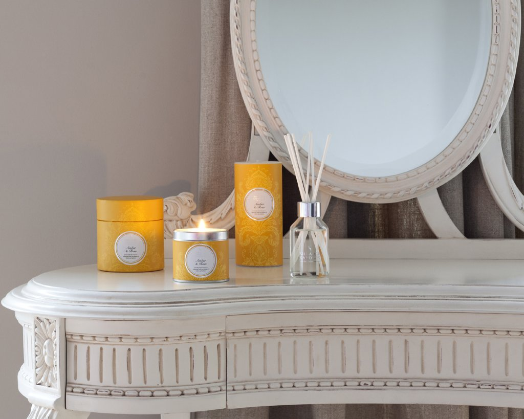 yellow candles at dressing table with mirror