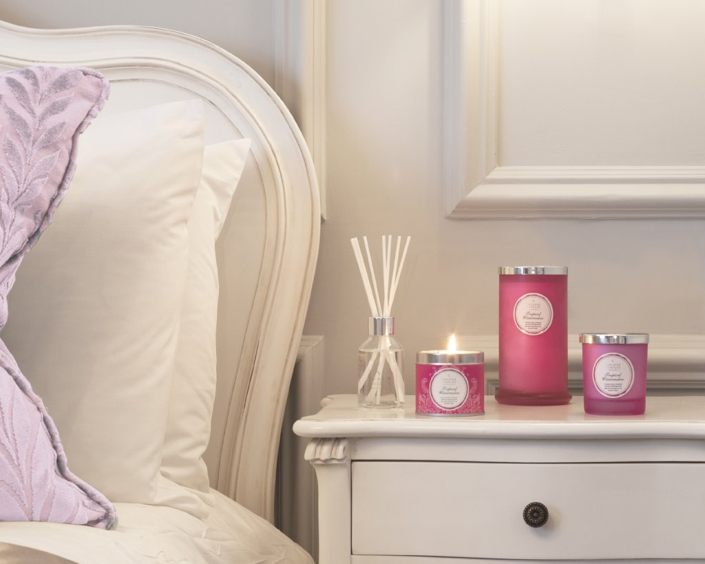 Pink candles at bedside