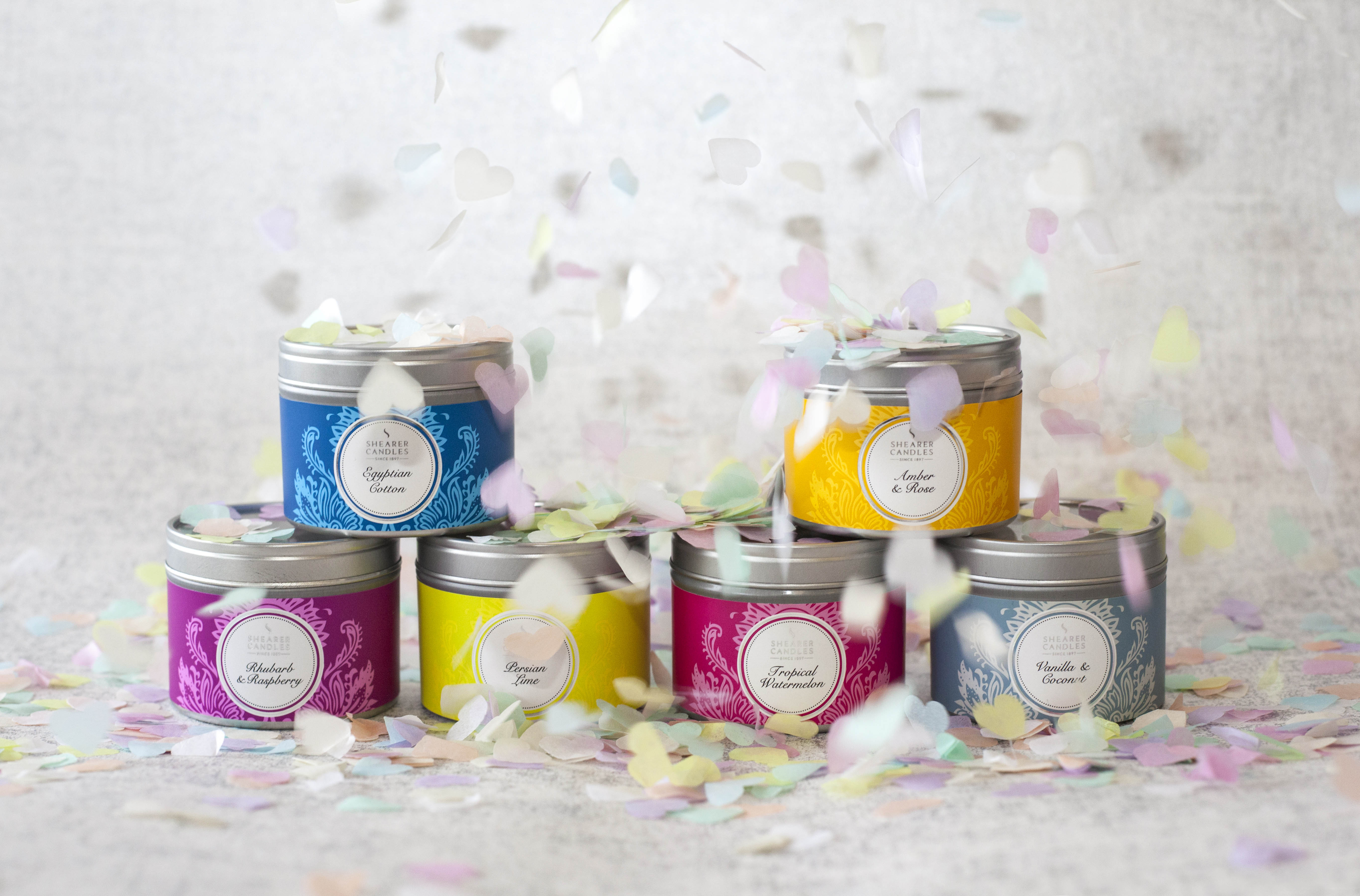 6 coloured small tin candles with confetti