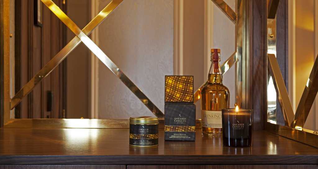 candles with whisky bottle